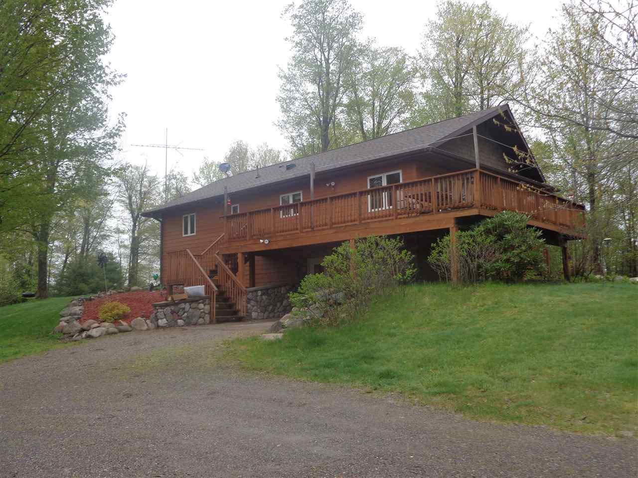 Lakefront 4 bed, 3 bath home with +/-665 ft. of frontage on Matt Ochs Lake and +/-6.67 secluded wooded acres. Oak kitchen with breakfast bar, dining with patio door, wrap around deck with water views and living room with tongue and groove vaulted ceilings. Master bedroom with full bath. Walk out basement with family room, gas fireplace, bedroom, 3/4 bath, storage room and laundry/utility room. Forced air lp furnace, central air, 100 amp electrical service and maintenance free cement board siding. Horseshoe driveway leading to a 48x42 heated metal shed with 16' ceilings. Drilled well, conventional septic system and beautiful landscaped yard. Gentle slope to lake for easy access for fishing and swimming. Abundant wildlife with trail system through woods. Located close to the National Forest and Mondeaux Flowage. Refrigerator, stove, washer, dryer, basement refrigerator, window treatments, metal shed wood stove, dock, canoe, dog fencing and remaining firewood are included in the sale price.
