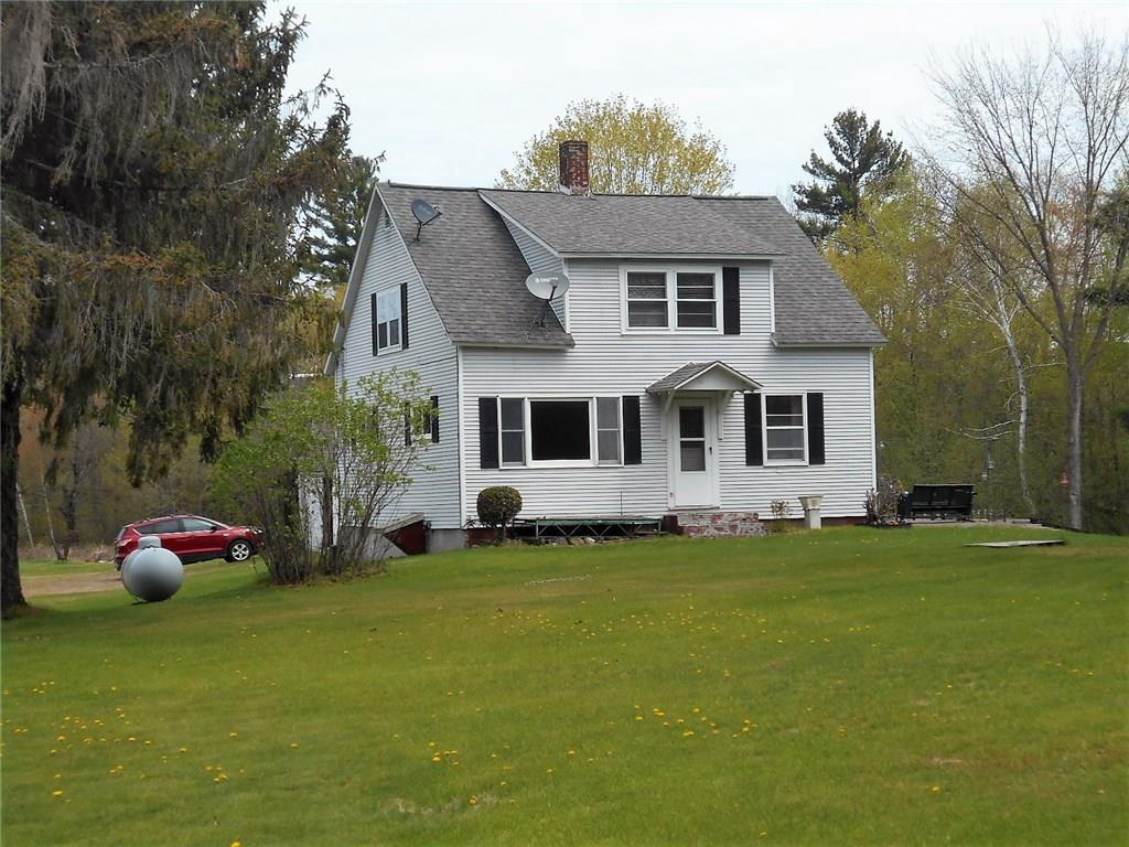 Rare opportunity to own 1700+ feet on the S Fork Clam River. This lovely 20 acre hobby farm has a nice kept 3-4 bedroom home, older detached garage a huge 26 x 40 shop, with in-floor heat, and a custom deer stand complete with satellite! The custom built cabinetry and work station/desk are a really nice touch. And wait until you see the nice patio area overlooking the river.  Most everything has been updated. Two buildings need attention. If taken down they cannot be rebuilt in same site.