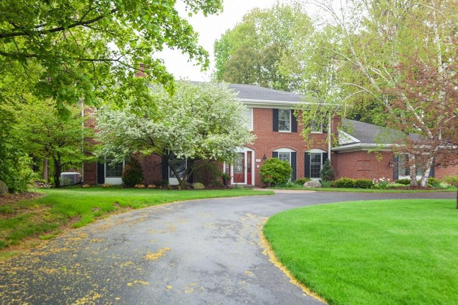 Impeccably maintained 5 Bedroom / 3 Bath brick colonial on the Milwaukee River in Grafton!Gorgeous custom cherry Kitchen features solid surface counters, island breakfast bar, pantry, a see-it-to-believe-it stainless fridge and dining area leading to brick patio.  Bright family room with natural fireplace also provides views of the beautifully landscaped backyard.  100 feet of river frontage on this 1+ acre serene lot.  Spacious living room with second fireplace & formal dining make this the perfect house for entertaining.  1st floor bedroom, bath and laundry.  Large Master has it all ...double sinks and walk-in shower in the ensuite, walk-in closet and a separate dressing area.  3 more large bedrooms and another full bath upstairs.  All this AND finished space in the lower level!