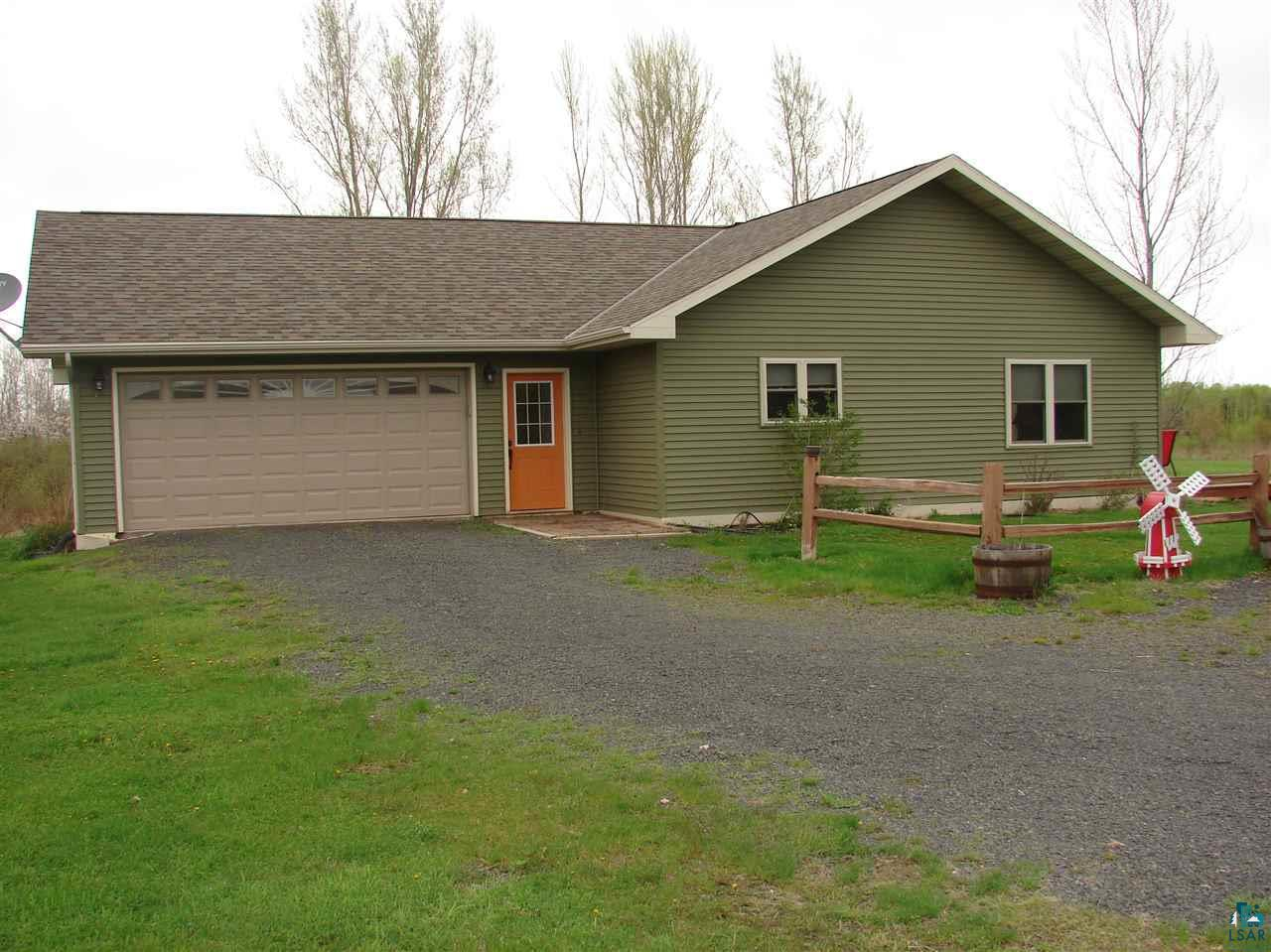 Ranch style home with 2 large bedrooms and open floor plan that walks out to backyard deck.  In floor heat in home and attached garage.  10 acres to explore and just a 2 minute walk to the Brule River!