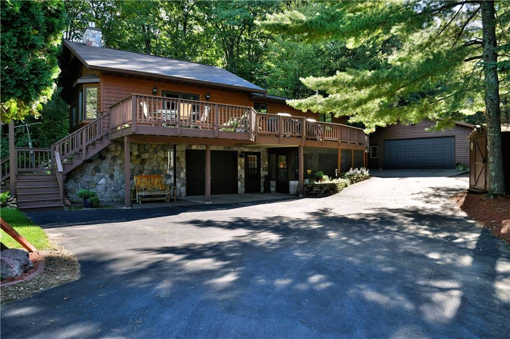 Meticulously Cared For 3 Bedroom, 1.5 Bath Home On Long Lake. This Is One Of The Premier Lakes In Northern WI. Fish, Boat, Snowmobile, Or ATV Right From Your Home! Cedar Sided W/ Cultured Rock And Large Deck. Vaulted Ceilings, Cultured Rock Fireplace, Solid Oak Cabinets In Kitchen and Solid Oak Doors In All Bedrooms. The Family Room In Basement Has One Wall Of Cultured Rock And A Pellet Stove That Can Heat The Entire House In The Winter. It Also Has A Walk Out To A Three Season Screen Porch. This Home Sits On A 3/4 Acre Lot With A Level Walk To The Lake And 61 Feet Of Frontage. Underground Sprinkler System From The Lake. Plenty Of Room For Your Toys In The 28'x36' Finished/Heated Garage With Workbench And Air Lines Built In The Wall For Air Compressor. 3 Utility Sheds For Extra Storage. Let This Be Your New Lake Home Today!