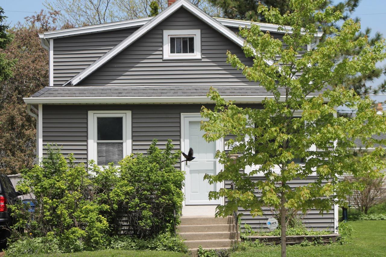 Why rent when you can own this 3 bedroom plus home with new maintenance-free vinyl siding. Inside needs a little ''TLC'' home has hardwood flooring and updated windows.