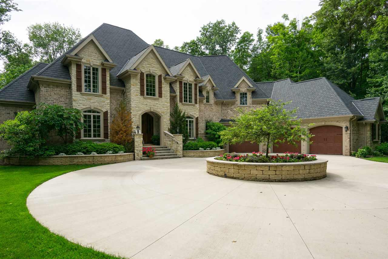 """This home is a traditionally elegant one-owner home on a secluded, fully wooded two-acre cul de sac lot! This architecturally designed French chateau home is a true castle in the woods! The back porch leads to a beautiful stone-walled concrete patio with wood burning fireplace. Inside find a curved open staircase in the foyer with second level overlooks.  The first floor has 9?-4+"""" ceilings.  The formal dining room has built-in glass cabinets. The vaulted family room ceiling is capped with timber beams. Exquisite kitchen with center island; master suite with tile shower and soaking tub!"""