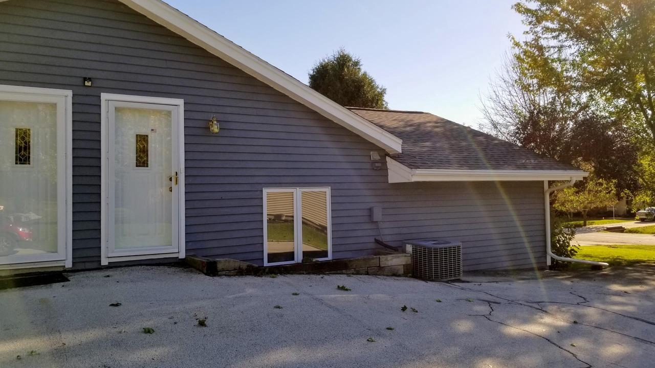 Tired of renting?  Take a look at this 1 bedroom rustic retreat!  Main level entry from garage/patio area. Living room shares space with dining area.    Also, you'll enjoy the use of the pellet stove.  Kitchen has plenty of counter space and appliances are included.  Laundry hook ups are available.  Upstairs is the bedroom and a full bath.  Newer roof & garage door. Golf course and bike path  are nearby.  Come take a look!  Motivated Seller !