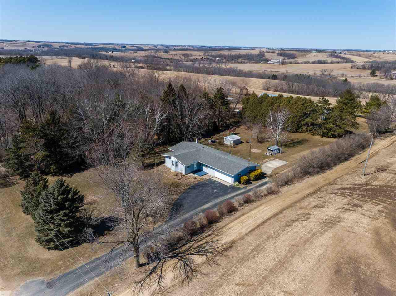 VRP $350,000-$375,000 - Peace & tranquility abound in this sweet 44-acre farmette where you can have horses & other animals! Approx. 32 acres of tillable land! 24x80 outbuilding w/loft & 2 horse stalls plus 3 additional smaller storage sheds! Bright ranch w/open floor plan & vaulted ceilings! Welcoming foyer w/lovely custom-built-in buffet! Nicely-updated bathroom! Master bedroom features built-in bay window seat that opens for storage + attached bonus room that could be your walk-in closet! Enjoy the wildlife while relaxing on your back deck! Attached 2-car garage! All appliances & UHP included! Some exposure in lower level! Beautiful land!