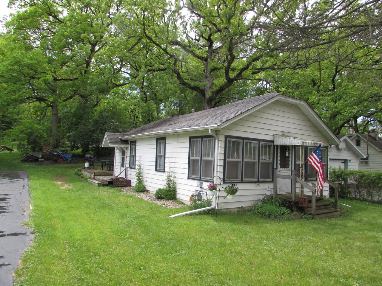 Quaint 2BR/1BA cottage that is perfect for a weekend retreat, summer vacation or rental. Less than a block away from Bohners Lake, this ranch home has lake access rights, boat slip and beach rights - all the attributes of lake living without the high price tag! Conveniently located to enjoy the area attractions. Updates include a newer roof and furnace.