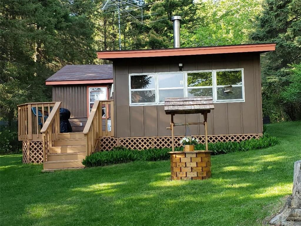 This cute 3 season 2 bedroom cabin has great views of Horseshoe Lake. With its flat elevation and sandy clean frontage makes it great for swimming for all to enjoy! Cabin comes furnished, includes Dock, swimming raft and riding lawn mower. Pontoon and farm tractor available for sale.
