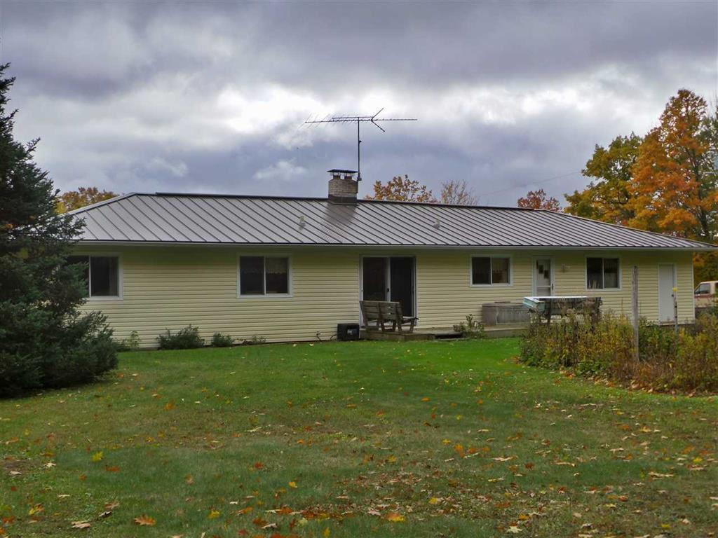 This 3 bedroom,  1 and 1/2 bath ranch-style house, is situated on 40 acres of beautifully wooded land. The home has recently been resided, and has had a metal roof installed, making it a very low maintenance home.  It has a 2+ car attached garage, and an outdoor wood-burning furnace.  All your fuel is available to you on your own property!  This well cared for property would make a great family home, as well as a perfect spot for hunting!