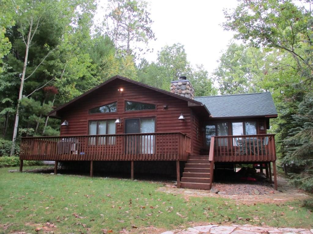 Very well kept, log-sided 2 BR home on 331 feet of lakeshore on Whitefish Lake nestled in 6.23 acres of privacy. This very efficient year around home provides excellent privacy on our area?s deepest lake. Many interior updates , 4 season room and new roof in 2017. Home has wood burning fireplace, knotty pine interior and large deck for enjoying and entertaining.  Upgraded counter tops in kitchen and bath.