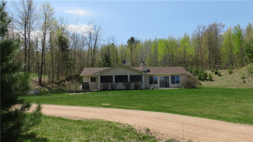 This property has it all! This perfect permanent or vacation home represents an amazing opportunity to have lake frontage and acreage. You could fish, swim, sunbathe on the beach, hike in the woods, hunt, and much more without ever leaving your own property! The home has been well maintained with newer roofing, new septic in 2017, and new well in 2018. There is an oversized garage and bonus spaces including a storm shelter, deck and screened porch. A two-sided wood fireplace facing the dining room on one side and the living room on the other makes for cozy living in this picturesque setting. The home has provided its builders years of lake living and hunting memories, and now, it's your turn to own this amazing property sure to provide endless fun and precious memories for you.