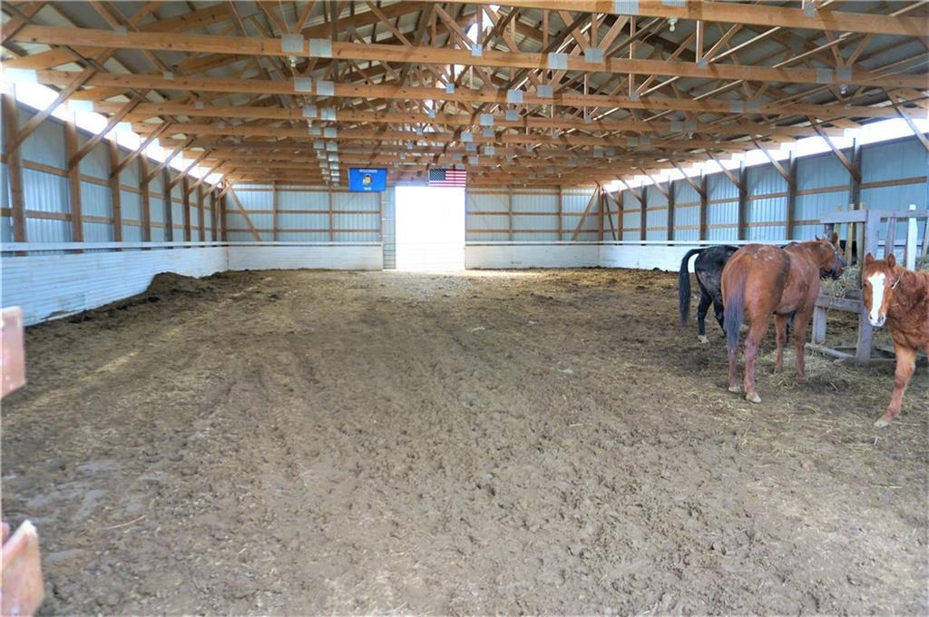 You will love the land and buildings on this 36-acre Hobby Farm!  Perfect set-up for horses, beef and show cattle.  64 x 104 indoor riding arena plus outdoor arena!  40 x 88 shed/barn has 3 parts:  Horse stalls, Hay storage, Tack room and shop area.  4 outside water spigots.  20 tillable acres rented and 4 acres pasture (24 total tillable).  This country home has character.  9' ceilings on main level.  Main floor laundry.  Large eat-in kitchen.  New furnace, shingles and roof sheeting in 2014.