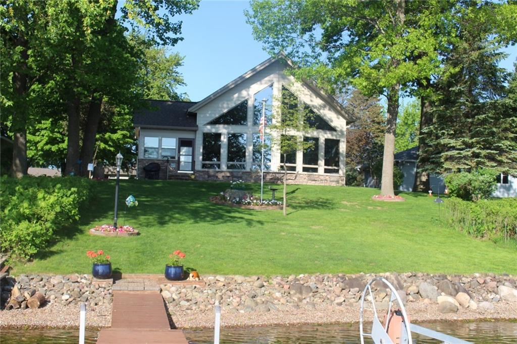 One of the finest homes on one of the finest lakes in NW WI!   You will be amazed by the gorgeous lake views the second you walk through the door.   Over 3700 square feet with main level large master suite, spacious loft, open concept kitchen/dining/living room, beautiful 4 season room, fireplace, finished lower level with rec room and wet bar, immaculate landscaping and more that must be seen to appreciate.  Located on 2580 acre Shell Lake, with sand bottom and crystal clear water!