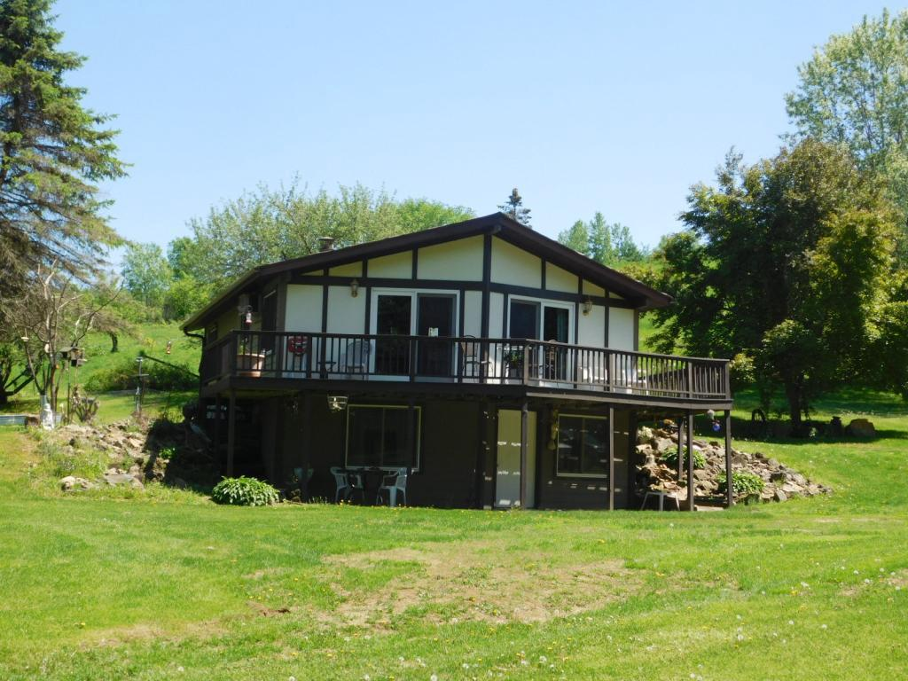 Come to the country where nature abounds while being surrounded by rolling hills & mature trees. Beautiful, peaceful setting w/a barn set up for steer calves & chickens, fenced pastures & 30x48 pole bldg. The house has an open floor plan w/vaulted box car siding ceilings w/beams, 2 bedrooms & bath up. Walk-out LL, both bedrooms in LL need egress windows to be legal, bathroom, rec & family rooms down. Wrap around deck & patio below. There are raised garden beds, rhubarb, raspberry bushes, apple, cherry and plum trees, grape vines & garden and storage sheds. This farm has been in the family for 150 years - you can be the next owner. NOTE: No photos were taken of the other bedrooms or LL because sellers are packing and boxing up their things. More pictures will come later. Auction is set for later in June.
