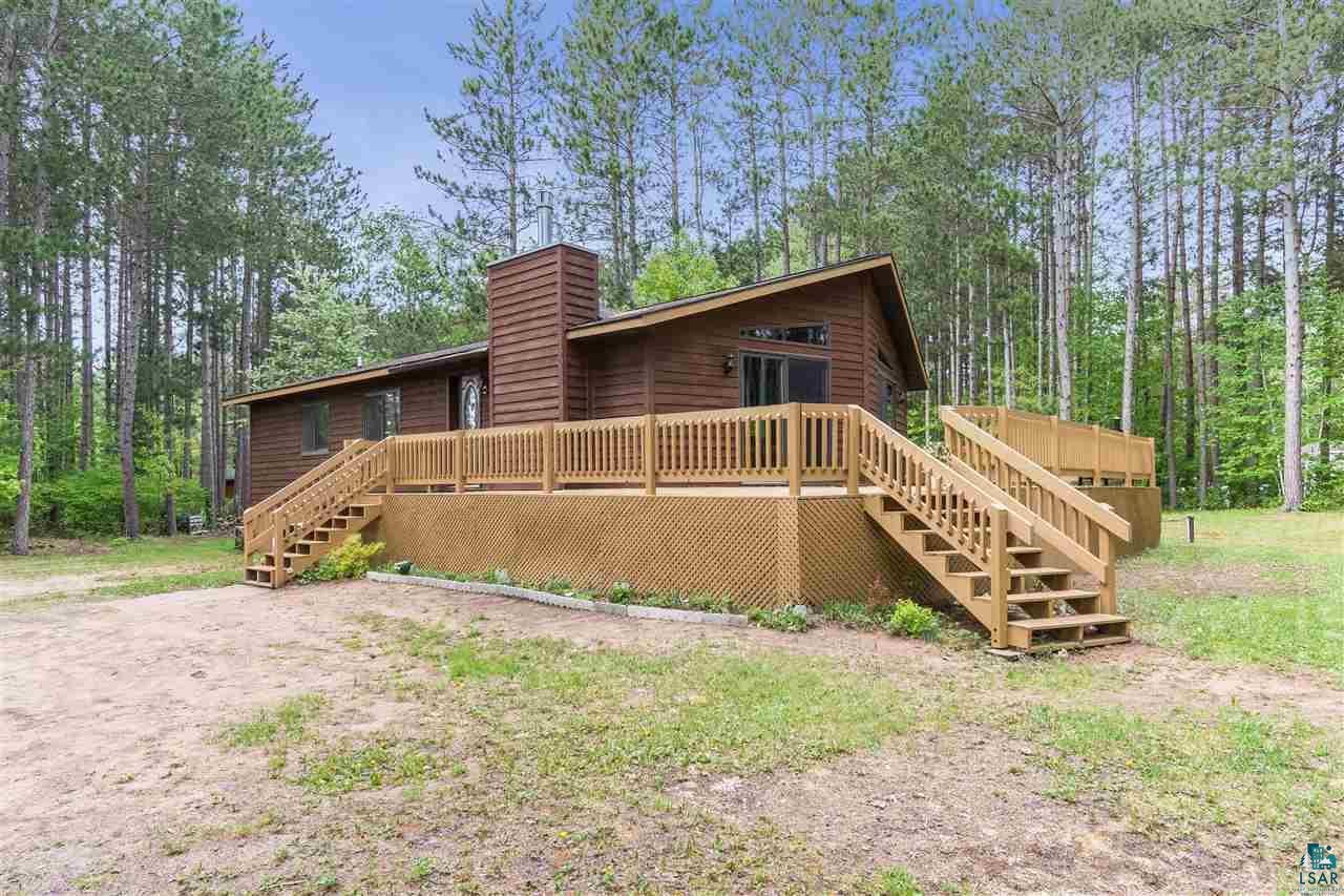 You don't want to miss the chance to own this impressive raised ranch home  tucked away in the towering pine trees of Brule.  If multiple bedrooms and bathrooms is a necessity, then this home is for you! Offering a master suite, 2 bedrooms, full bath, and laundry all on the main floor. Large 2x2 ceramic tile though out the high traffic areas and new carpet everywhere else. You can snuggle up to the gas fireplace in the winter, and enjoy the sunshine on the large deck in the summer. Now you can complete the package with a 3 car garage and large yard.  Enjoy all the amenities Brule has to offer, the Brule River, ball fields, restaurants, bank, gas stations, post office, etc.  Brule has it all just 30 minutes from Superior!