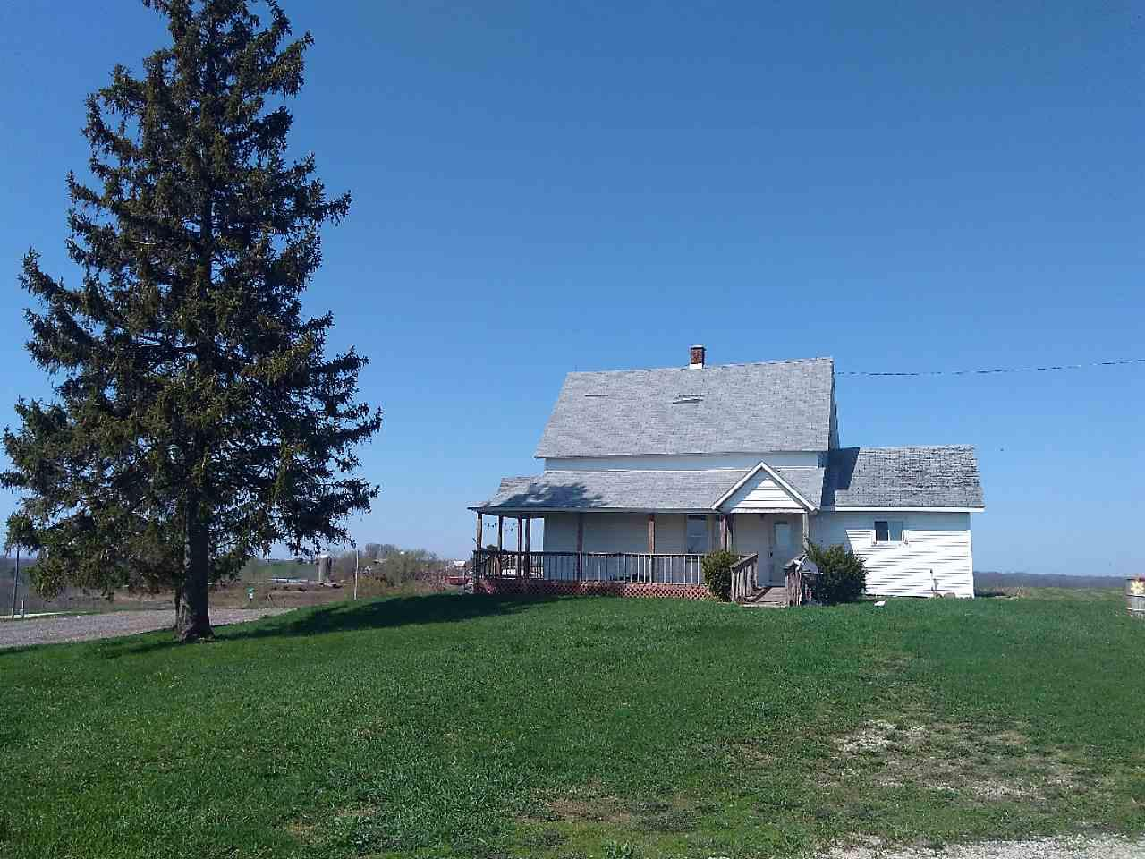 Beautiful homestead with breath-taking views on peaceful ridge near the Mississippi River! This farm includes with a 80x40' machine shed, 42 station milking barn, 3 car garage, small calf shed and 2 corn cribs. The home has a new furnace, hot water heater, ventilation in bathroom & added insulation to the attic! There is a bedroom and laundry on the main level as well as a covered porch with a ramp, to take in the morning sunrises. There is approximately 15 acres of tillable ground and 5 pasture.  This property sets up well for a hobby farm or for growing produce! Home needs some TLC. Selling AS IS.