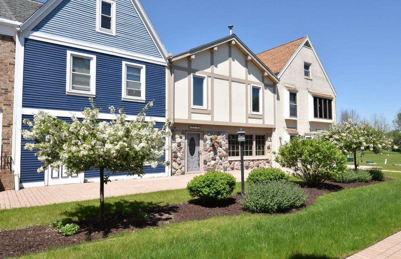 Located in a European design condo village, this two-story unit offers charm with its open floor plan on two levels. Two updated full baths, hardwood floors, stainless appliances, natural fireplace and large redone upper deck with outside stairway add to the appeal. First floor laundry, full 10 course basement. There are both eastern and western views overlooking the peaceful acreage. All owners have access to the pond available for kayaking, fishing and canoeing, walking trails and center brick courtyard. The Stonecroft community offers a quiet country setting situated just minutes from Lake Michigan, Port Washington and Grafton. Pet friendly.