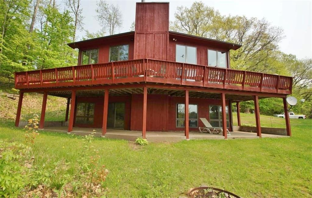 NEW PRICE! Long Lake-Spectacular southern views, unparalleled privacy at this 4 BR/3Ba chalet. With 354 feet of sandy shoreline & 6.89 acres, this rarely found site is the home to a well cared for cabin boasting expansive lake views. Enjoy sunny southern exposure & private Boy Scout Land across the lake. Wet boathouse. Golf cart path to lake. 1.89 lakeside parcel & 5 acre backlot--both can be further developed as cabin is situated on west end of lot. New exterior stain in 2018, New roof in 2017.