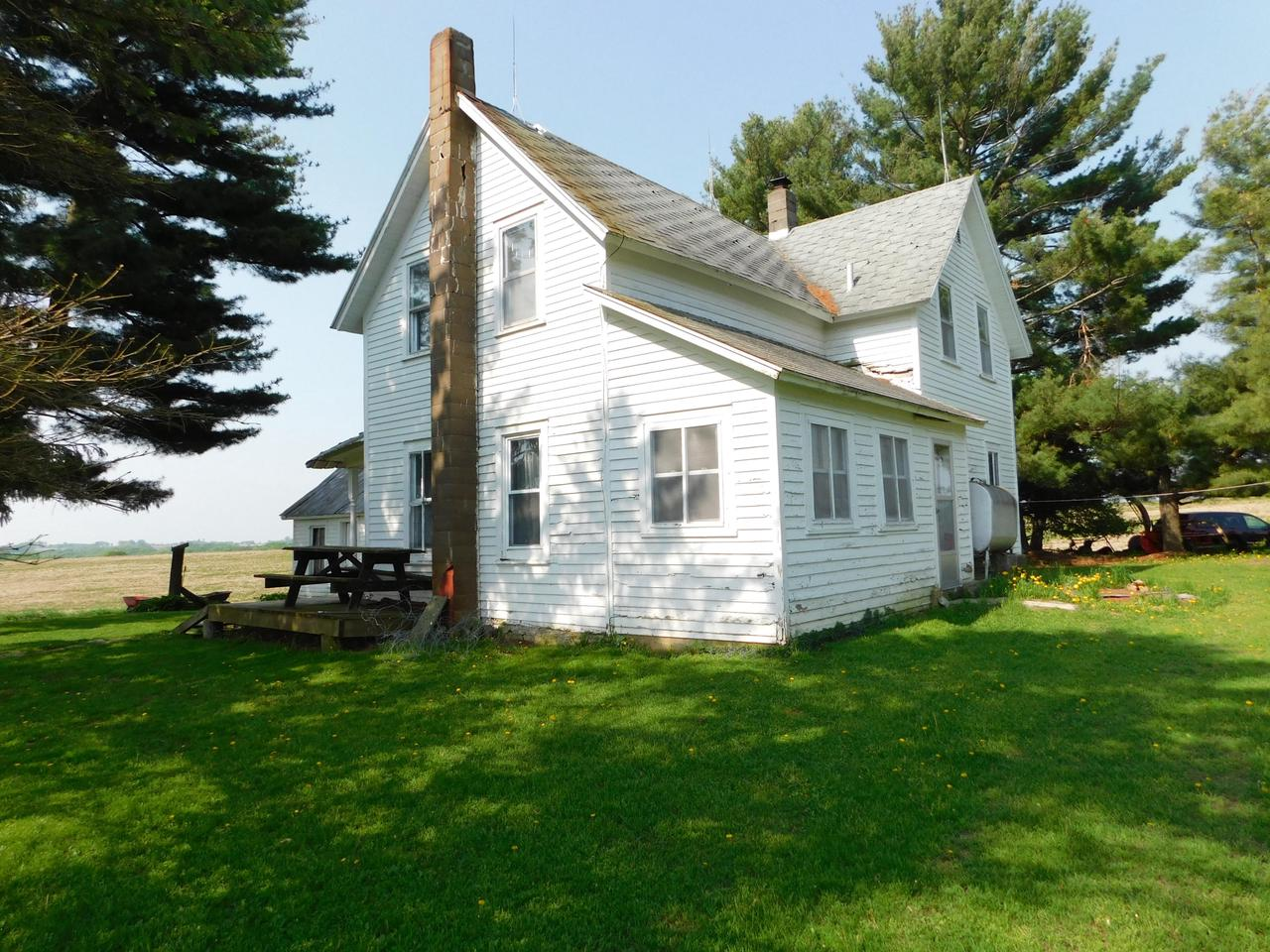 Beautiful country setting waiting for you! This 4 bedroom 1 bath farmhouse  is being offered with 40+/- acres on a Sealed Bid. Outbuildings include a barn, shed, and summer kitchen.  Sealed bid packets available thru listing agent and on sign at property