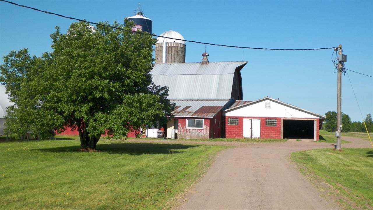 """Lots of possibility with this former dairy farm with many usable outbuildings. Great for animal housing or """"big toys"""" storage. Only minutes from Lake Holcombe. Farm is listed with approximately 12 acres subject to a survey. But up to 232 acres are available. See MLS number:1859253"""