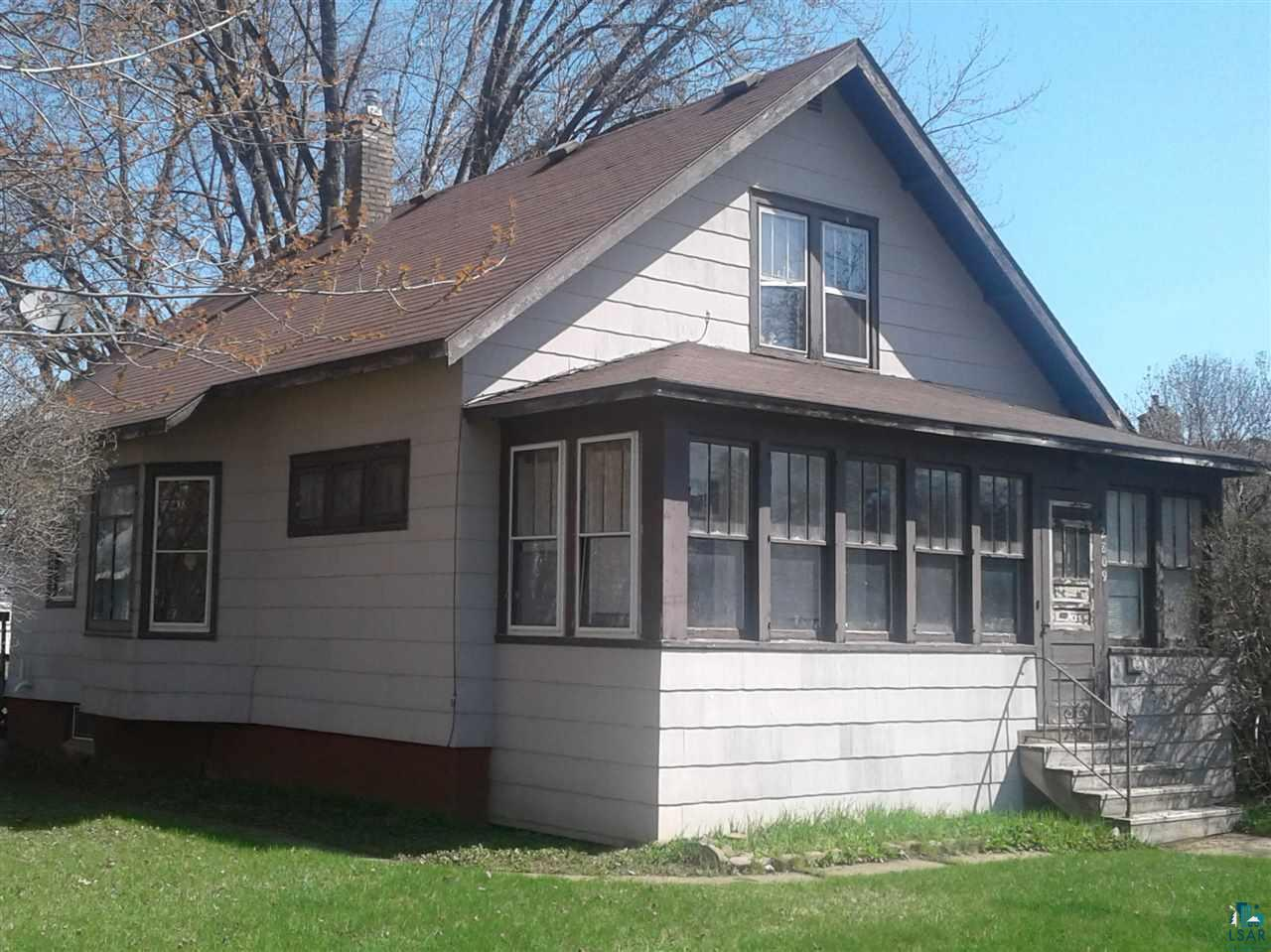 A tour is worth your time on this classic, well-cared-for Billings Park  2+ BR with detached garage.  Enclosed front porch.  Hardwood floors, formal living room, and main-floor bath/bedroom with den area.  Large bedroom and loft area in the upper level. Newer furnace/water heater.  The seller is ready for your offer.  See it soon!