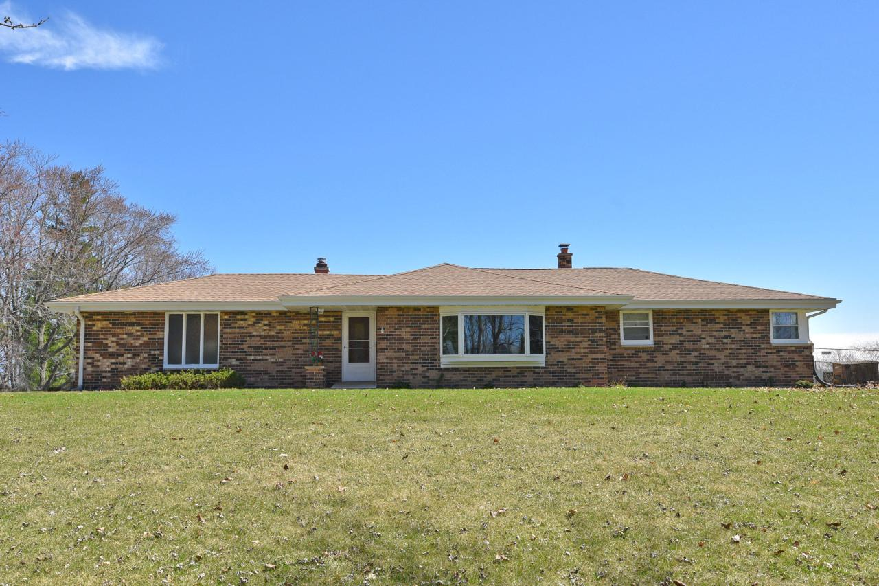 Brick ranch in the country on 2.2 acres. Open view kitchen, dinette and family room with natural fire place. Living room with L shaped dining area. Newer kitchen counters. Wooded lot with backyard country views to enjoy sunrises. Newer roof and fascia boards installed in 2014. Newer furnace, water heater and water softener in 2018. Fenced-in area for your dogs. Currently rented. Use as an investment property or move to the country and make it your own. Great location, very private and easy access to I-43.