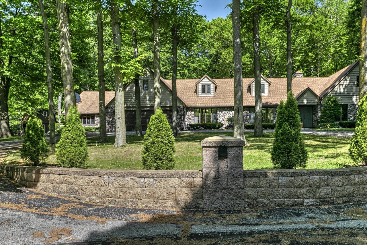 NATURE LOVER'S PARADISE! Private and peaceful custom home has it all! This sprawling ranch with a cobblesome exterior has so much to offer including oversized deck, 1 yr old furnace & AC, 4 bedrooms with a huge Master Suite w/walk in closet, 5 baths, marble foyer, newly updated  Gourmet Kitchen with island, updated light fixtures,crown molding, hard wood floors, natural fireplace,a spa room of knotty cedar,wet bar, indoor pool plus large whirpool, finished lower level w/rec room, bar & bonus room, AND ..the list goes on. This is the one you've been waiting for!