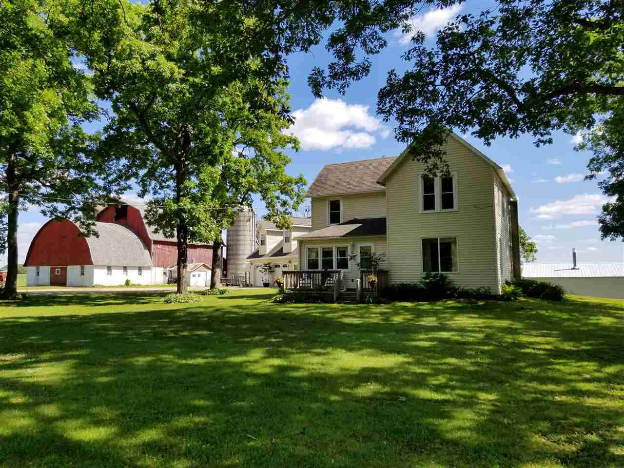 MUST SEE TO APPRECIATE!!!!  Charming farmette with just under 5 acres and only one mile East of Wis. Dells.  Homeowner has taken immaculate care of this home for 24 years.  Recently updated electricity, plumbing and septic while still keeping much of the original details. Great place to raise a few horses, cows, chickens or children! Pasture is already fenced in!  A Central Boiler Wood Stove efficiently heats the entire home and garage with LP as an alternative system. 900 sq ft garage/entertainment area with an upstairs living room and bedroom.  Call Lisa today to look at this unique property! 608-432-1069