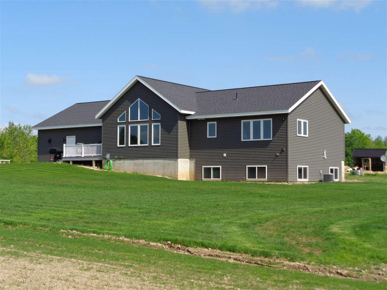 Beautiful 4+ bedroom, 3 bath ranch style home built in 2018. Home is located on +/- 80 acres. Features an open concept kitchen/living and dining room, custom built cabinets and brand new appliances. Property also features a central vacuum system, main floor laundry room with built in shelving, 3 season room, deck and 4 car insulated and heated attached garage. Lower level is finished with a family room, two bedrooms and bonus room. Drilled well and mound septic system. The stove, refrigerator, microwave, dishwasher, washer, dryer, pool table, lean-to and carport are included in the sale price.   The land features +/- 80 acres with a nice trail system, rolling hills, abundant wildlife, food plots and a pond. 1/4 mile rifle range located on property. Seller to plant 500 trees in the spring of 2019 including white oak, red pine, white spruce and cranberry bushes.