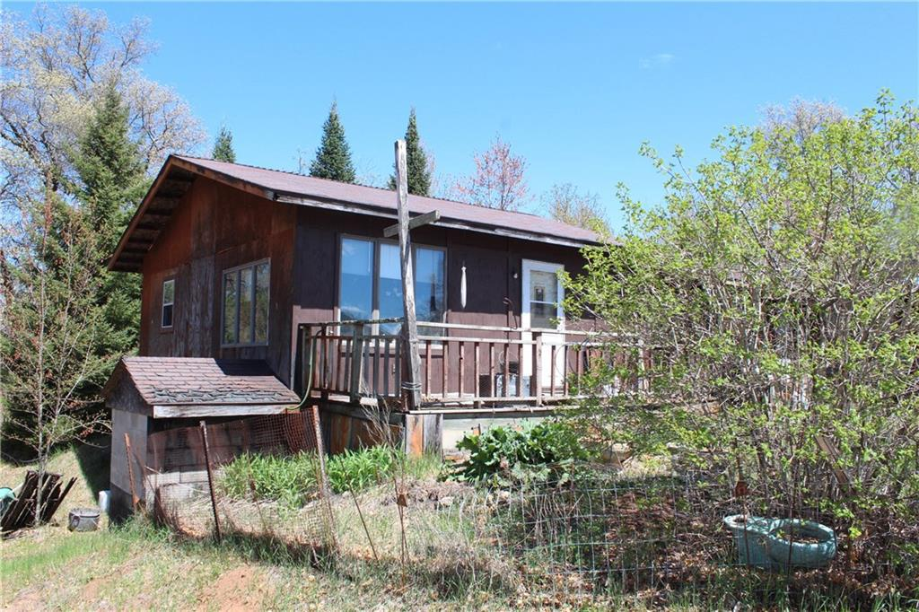 Lots of options to finish this home- has a full walkout basement, barn, car port, 3 car garage. Great hobby farm with creek running through it. Public trails across street for horse riding, snowmobile trail and ATV trail.