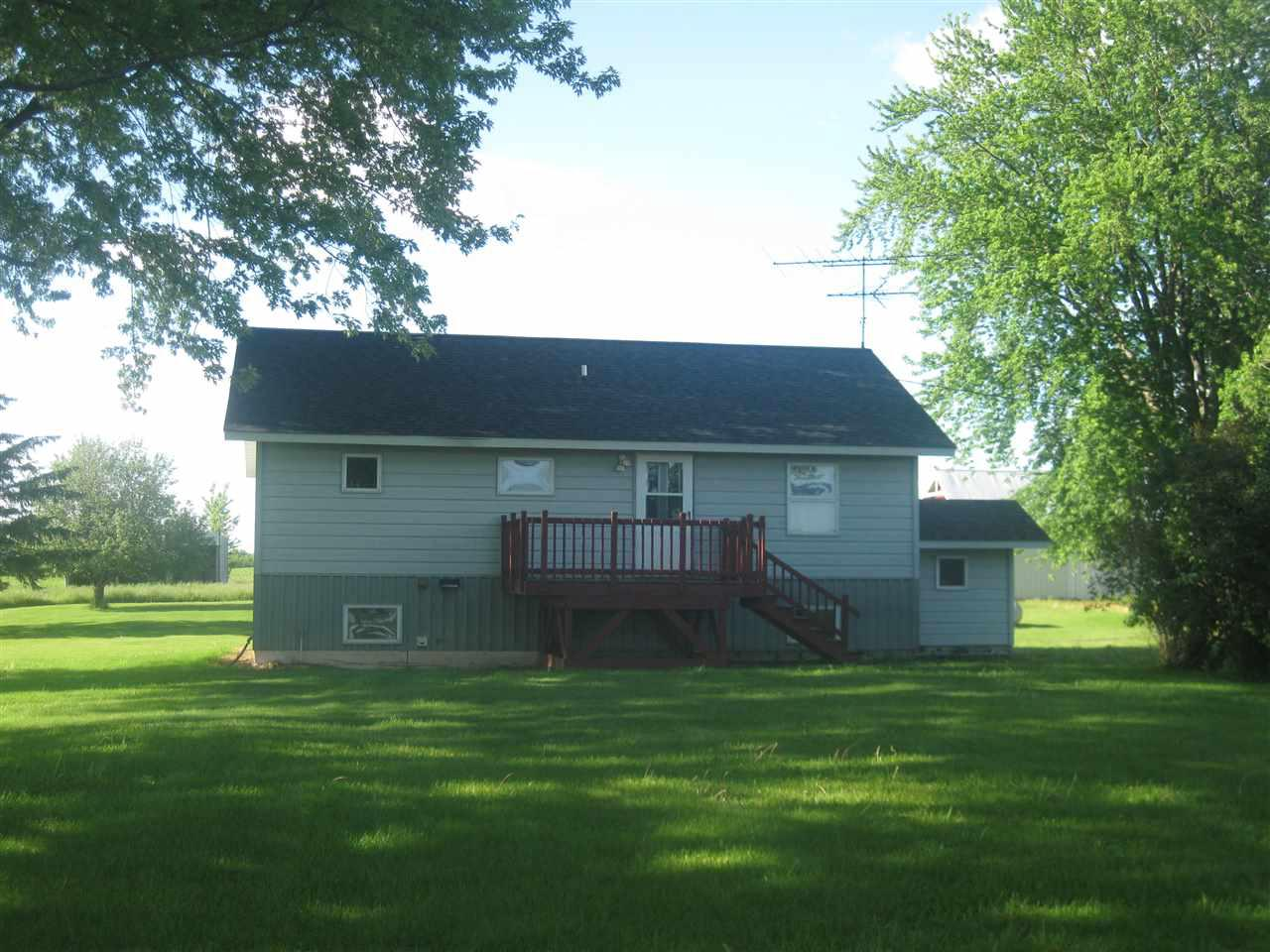 Great Hobby farm, with well maintained home and out buildings.  Features 2 story barn,  and two large pole buildings.  acreage is fenced in and would be perfect for horses or a few beefers.