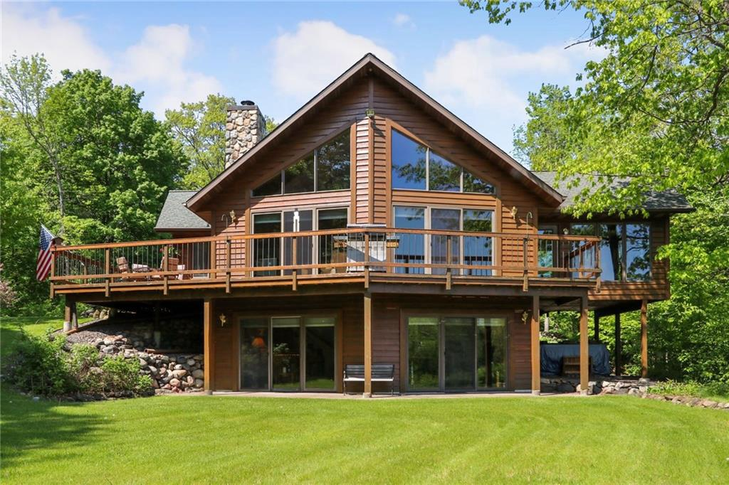 Unbelievable expansive view of the mighty Chippewa River from your deck & most every room in the Home. This is a solid quality-built 3bdr/3ba Chalet-style home with full finished walkout lower level.  Spacious, open & bright with storage utilized in every area of the home. Open concept with vaulted oak ceilings, woodstove, jacuzzi bath & main floor laundry. Lower level boasts in-floor heat, a wet bar with historical nuances, workshop & full bdr/ba for guests. Attached 2+ car garage with heated floor. And a 4 season room for enjoying those summer breezes. Also has an asphalt drive and a 45'x40' Morton Building, wired with 220 amp. ATV/snowmobile trails you can directly access, and golfing, hunting lands and several dining establishments are nearby. About 3 hours to the Twin Cities area & about 30 mn to Hayward, Ladysmith or Park Falls. Well thought out classy home with so many features we cannot mention them all. This one is a must see to appreciate.