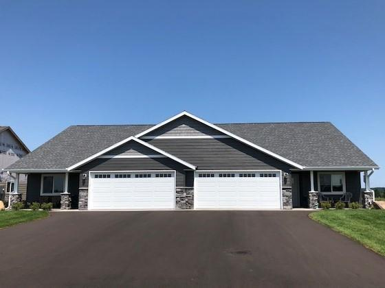 Welcome to the newest luxury development of St Croix Falls Chinander Ridge .  Surrounded by 449 acres of Family owned wild life and nature preserve. These Town-homes are custom to your desire.  Featuring a 1553 sqft home comes with all the amenities one would need in a home, including: luxury tile, granite, custom designed kitchen and bathroom plus a beautiful  4-season porch overlooking the matured trees and trails of St Croix Falls.  Within walking distance to downtown and all that has to be offered in historical St Croix. This development is one of the most beautiful desired areas of the town. You feel like you are in the country but yet only minutes to all the shops, restaurants and hwy 8 for easy commute.  Only 60 minutes to Stillwater.  Choose from exquisite options to make this your dream home.  Welcome to Hilltop Preserve Townhomes.