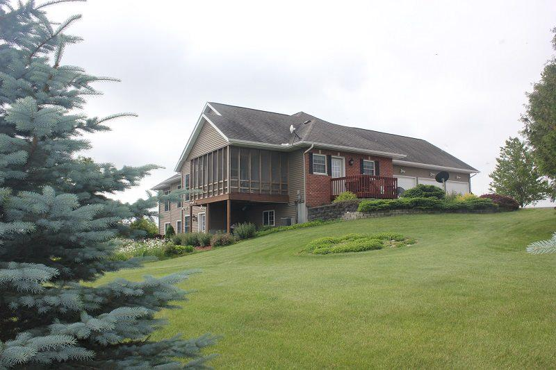 Once in a lifetime, this farm has it all!  Stunning custom built 2002 executive home will leave you breathless. Open floor plan, granite kitchen, huge vaulted great room, stone framed gas fireplace.  Large master suite with 2 walk in closets, 3 season porch, concrete back patio for outdoor entertaining.  Lower level features in floor heat and 3 walkouts.  Horse and livestock friendly!  2 pole sheds with power: 50x100 open side with 60x100 concrete lot and water.  48x96 with box stalls.  Buy the whole works or will divide.  119 acres with 74 cropped, 23 woods.  A showplace you are proud to call home!