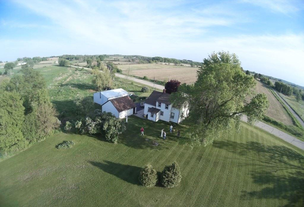 Location, location, location! Bring your finishing touches to this cute, 3 bdrm 1.5 bath cape cod on 7.5 acres on a quiet country road adjacent to the 4000 acre Waterloo Wildlife Area. There?s a small stream running thru & it?s zoned A-1 so bring your horses or hobby farm animals. Updates incl. metal shingled roof, energy eff geo-thermal heating & AC system, water softener, iron filter, upstairs windows & more. 1st flr bath was remodeled in 2016 & half bath was added on 2nd flr. There?s a 2 car gar & a 30? X 32? steel building that?s partially insulated, wood heated & ready for the enthusiast!