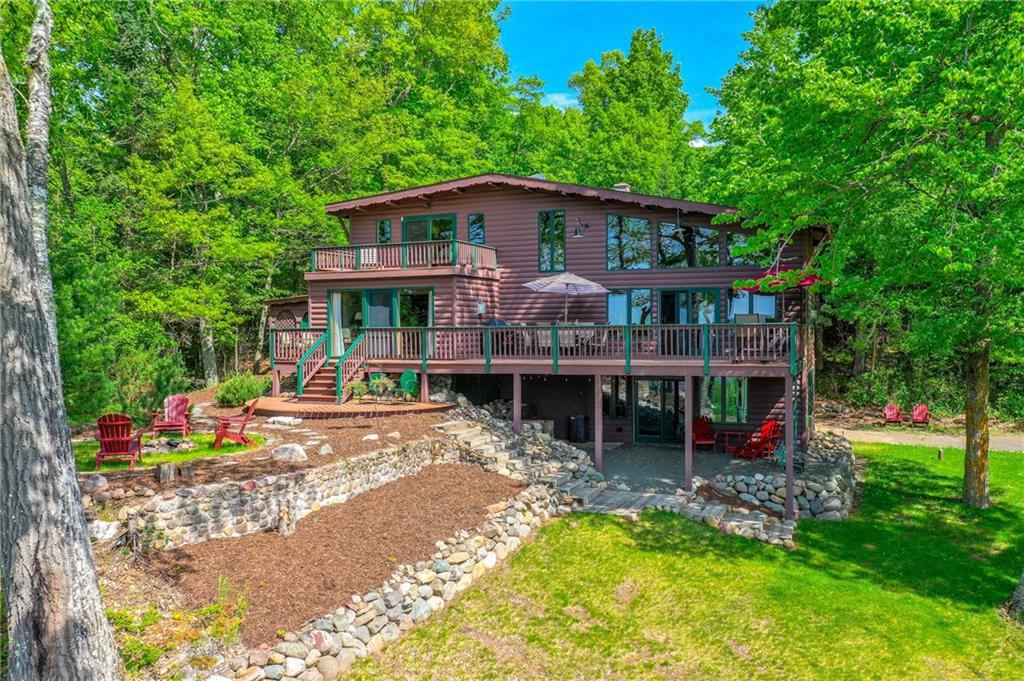 Welcome to Hemlock Lodge on Spider Lake! With 14+ acres and 865 feet of meandering shoreline, this gem gives you the wilderness feel you need and the privacy you want. Gorgeous 3 BR/3 Bath remodeled lodge has been well cared for and will be the envy of your friends. Amenities include 18x25 screen porch, open concept kitchen/LR, lakeside den/dining room, Master suite with amazing views, 3 fireplaces, 32x32 dock platform for island & wildlife viewing, newly remodeled lower level. 40x60 pole barn. Abuts State owned lands.