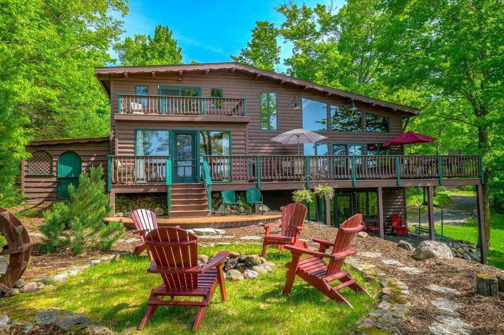 Welcome to Hemlock Lodge on Spider Lake! With 14+ acres and 865 feet of meandering shoreline, this gem gives you the wilderness feel you need and the privacy you want. Gorgeous 3 BR/3 Bath remodeled lodge has been well cared for and will be the envy of your friends. Amenities include 18x25 screen porch, open concept kitchen/LR, lakeside den/dining room, Master suite with amazing views, 3 fireplaces, 32x32 dock platform for island & wildlife viewing, newly remodeled lower level. 40x60 pole barn.
