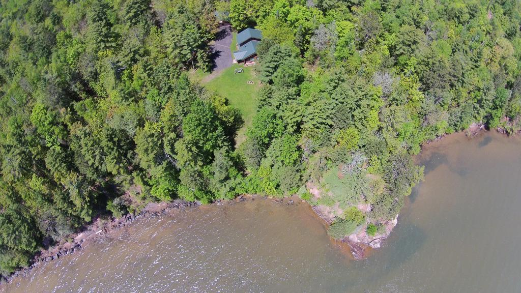This truly one of a kind Lake Superior log home has it all! The lake frontage is a very rare find with your own private brownstone point for swimming, kayaking, or just relaxing! This log home is surrounded by forest so no visible neighbors. Everything throughout the home has been update with quality. Custom logs, cathedral ceilings, panoramic views of the lake, main floor bedroom, cherry kitchen cabinets, beautiful fireplace, enclosed library area with sauna that overlooks the seasonal creek.