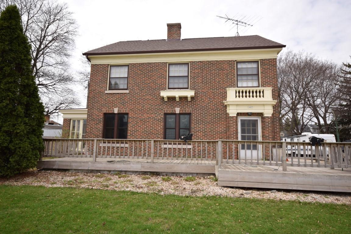 Come see this 4 BR, brick colonial on 1/3 acre lot with 4 car detached garage.  Features include hardwood floors throughout, spacious bedrooms, huge living room with fireplace, large sunroom, walk in closets in most bedrooms, expansive 3rd floor attic for additional storage with cedar closet.  Lower level with rec room and full bath. New roof. Newer furnace. Call today!