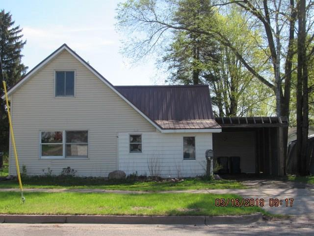 1.5 story home with steel roof and some interior renovations done waiting for your finishing touches. Main floor bedroom and bath with an eat in kitchen. Large backyard overlooking  Red Cedar River