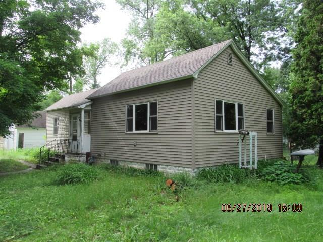 Priced  25k under assessed value! 1 story vinyl sided home with hardwood floors,dining room,some updated windows and located on .80 acres within minutes of Downtown Chetek,lakes and schools. Some TLC needed.