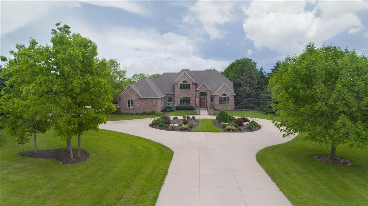 Enjoy the quiet surroundings & beautifully landscaped lot of this custom built home by Jacobs Construction, located on a double lot with 1.92 acres on Westridge Golf Course. Upon entering you will notice the quality craftsmanship in the finishing details. The gourmet kitchen opens to a family room with vaulted ceiling, wet bar and tons of windows bringing the outdoors in. Also on the main floor is a guest suite. The LL is ready for you to design with walk out to the patios. This is a great home for everyday living or entertaining.