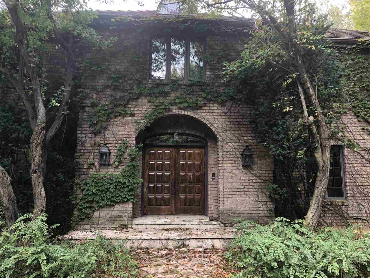 """Imagine a Country Club Lifestyle, Airbnb-Corporate-Spiritual Retreat? Choices?  Recharge on your 8+wooded/open acres. Brick Tudor w/ Tile roof. Wander through magnificent, special, formal and casual rooms, library, tranquil 4 seasons room, volume ceilings, crown moldings, warm cherry paneling, marble, slate and plank teak flooring, 2 FP's, updated kitchen, butlers pantry, wet bar, stained glass. Upstairs, 4 king-size BR suites. FP, Expansive LL:  2 lg entertaining areas,  FP, 2 full baths, endless options w/4 more rooms, access to 3.5 car garage. Old World Charm, own """"Something Truly Special""""!"""