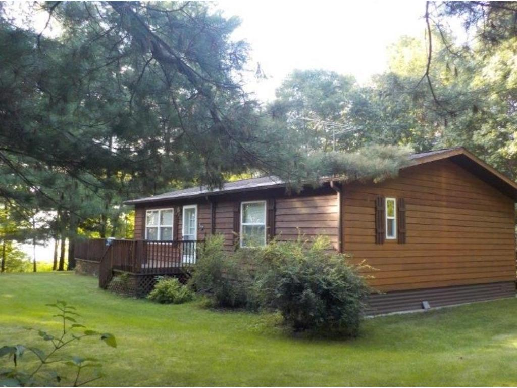 200' of frontage on popular Mudhen Lake. Lake shore is sandy with minimal tree coverage. Home has 2 bedrooms, 2 baths, large kitchen/dining area with a deck overlooking the lake. Easy lake living in this low maintenance, year around home.
