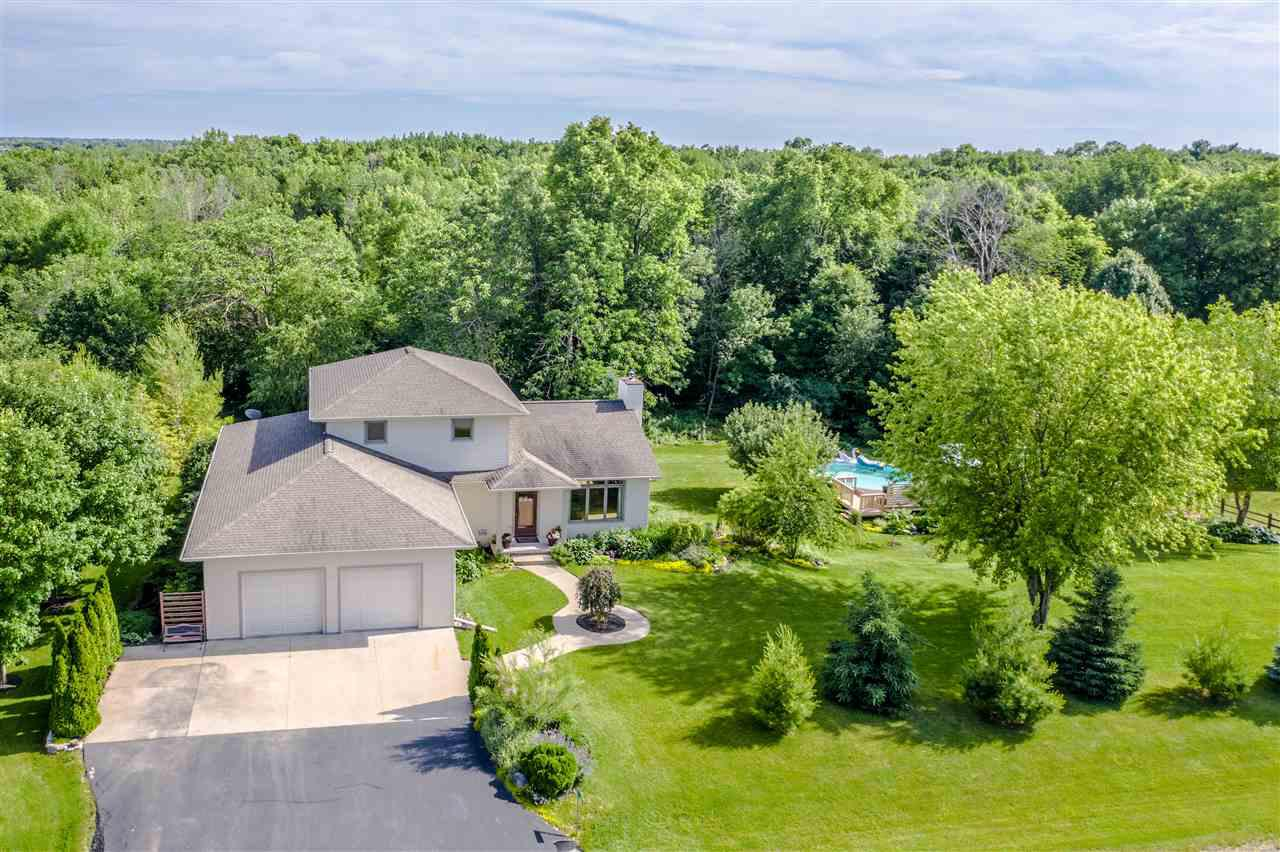 Pride of ownership, custom built home situated on 1.5 +/- acres. Main floor welcomes HW floors, living room and dining area with WB fireplace. Kitchen boasts bountiful cabinetry, hard surface counters and SS appliances. Half BA and laundry connects to master walk-in closet. Master suite featuring tiled shower and jetted tub. Upstairs find two LG BRs and jack-and-jill full BA. Walk-out LL boasts family room, bar area, rec room, in floor hydronic heat and full BA w/ walk-in tile shower. Above ground pool w/ deck. Features: garage basement access, at grade mound, LG mudroom, & Neenah schools!