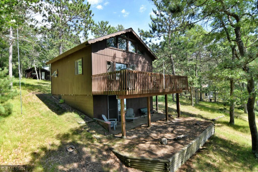 What a setting...121' of sandy beach overlooking one of the islands. With Western exposure, the wooded lot sits on one of the widest parts of the Flowage. Sit on the deck to watch the sunsets which can become your favorite habit. 2+ bedrooms and 2 baths. Living room with wood stove has windows to the lake. 3 season porch. Large loft is divided into 2 sleeping areas. Walk out basement, single garage plus 30x56' pole building with workshop and heat. A perfect lot for perfect cabin living.