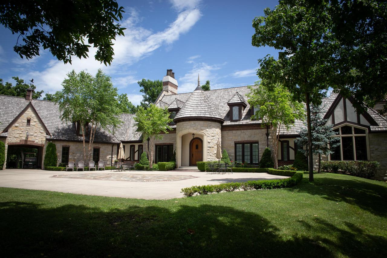 French Country Estate on 9.82 wooded acres with a private 4 acre spring fed lake (stocked w/ fish).  Situated just north of the Illinois/Wisconsin border, this picturesque country location is buffered by farm and woodlands yet is within a minute drive of I-94.  This uniquely crafted home was built in 2009 with world class craftsmanship and has been meticulously maintained with over 5,000 square feet of living area & potential for over 8,000 square feet with the exposed basement waiting for finishing touches. The extravagant, yet cozy home overlooks the private lake with a sunset view. In addition to the home is a horse barn. This is a dream estate and great investment in a growing market.