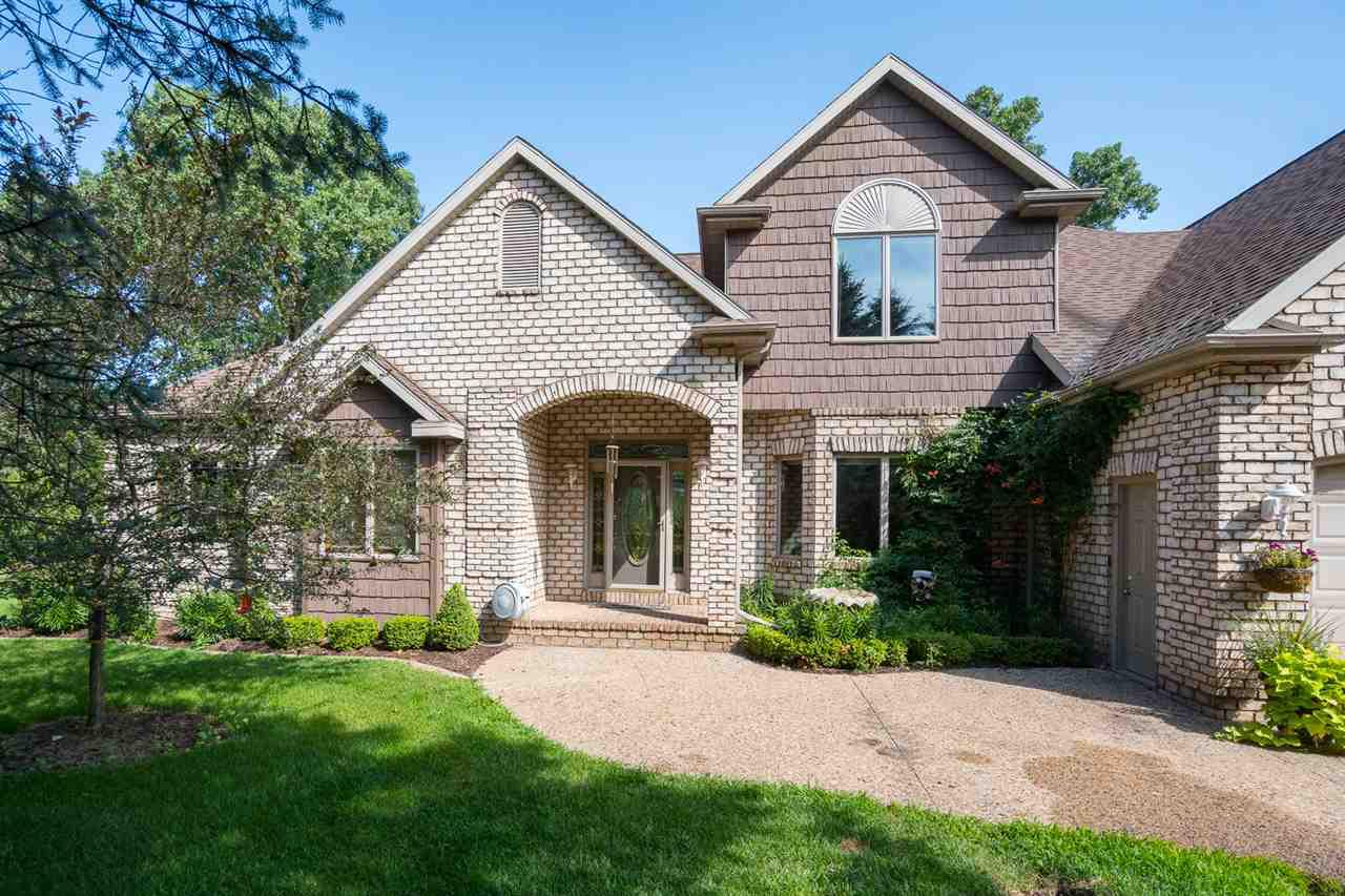 A breath of fresh air and a place to relax sums up this property. Nestled on a nearly 2.5 acre wooded ravine lot w/your own private pond. Deciding on whether to sit on the patio or the large deck doesn't sound like much of a problem, however, that will become a choice you'll get to make at your new home! 1st floor master suite w/FP. LR w/a wall of windows and gas FP. Upper level is where you will find 3 additional BRs, full bath and a generous bonus room. Entire upper level has w/ wet bar area, game area, FP and full bath. 2nd garage is an ideal space for an at home business. Come on over!