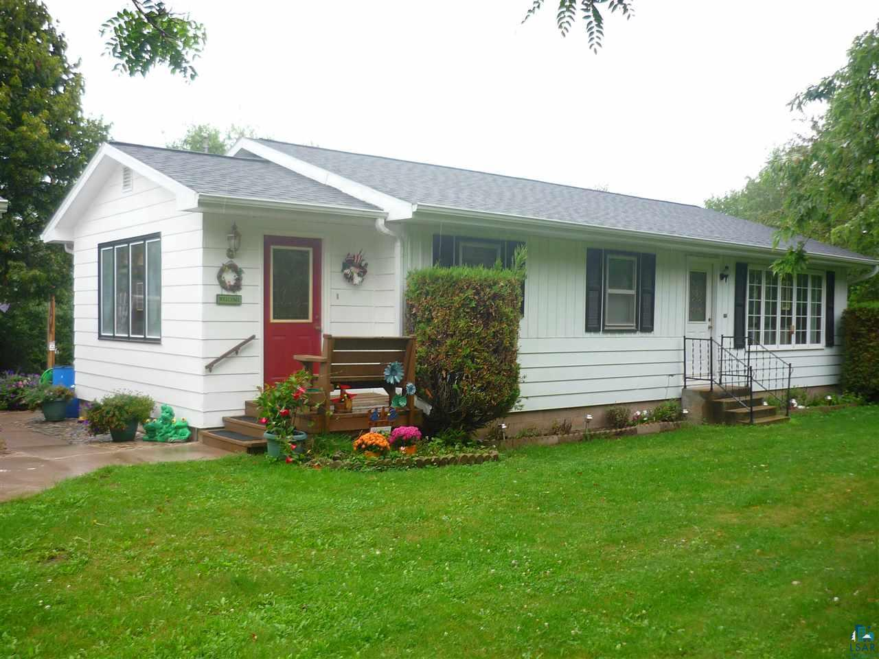 Solidly built and well maintained ranch style home with 3 bedrooms on the main level and another room in the finished basement that is currently used as an office that was a 4th bedroom.  The eat-in kitchen has custom cabinets and built in hutches and the lower level is finished with large family room, office/bedroom, sauna, bath and lots of storage.  There is hardwood maple floors in living room and bedrooms on the main floor underneath the carpeting.  28x36 garage with heated shop, 8x36 deck, man made pond and 3 season gazebo for backyard enjoyment.  This property has direct access to the corridor for recreational enjoyment and is close to Ashland for convenience.