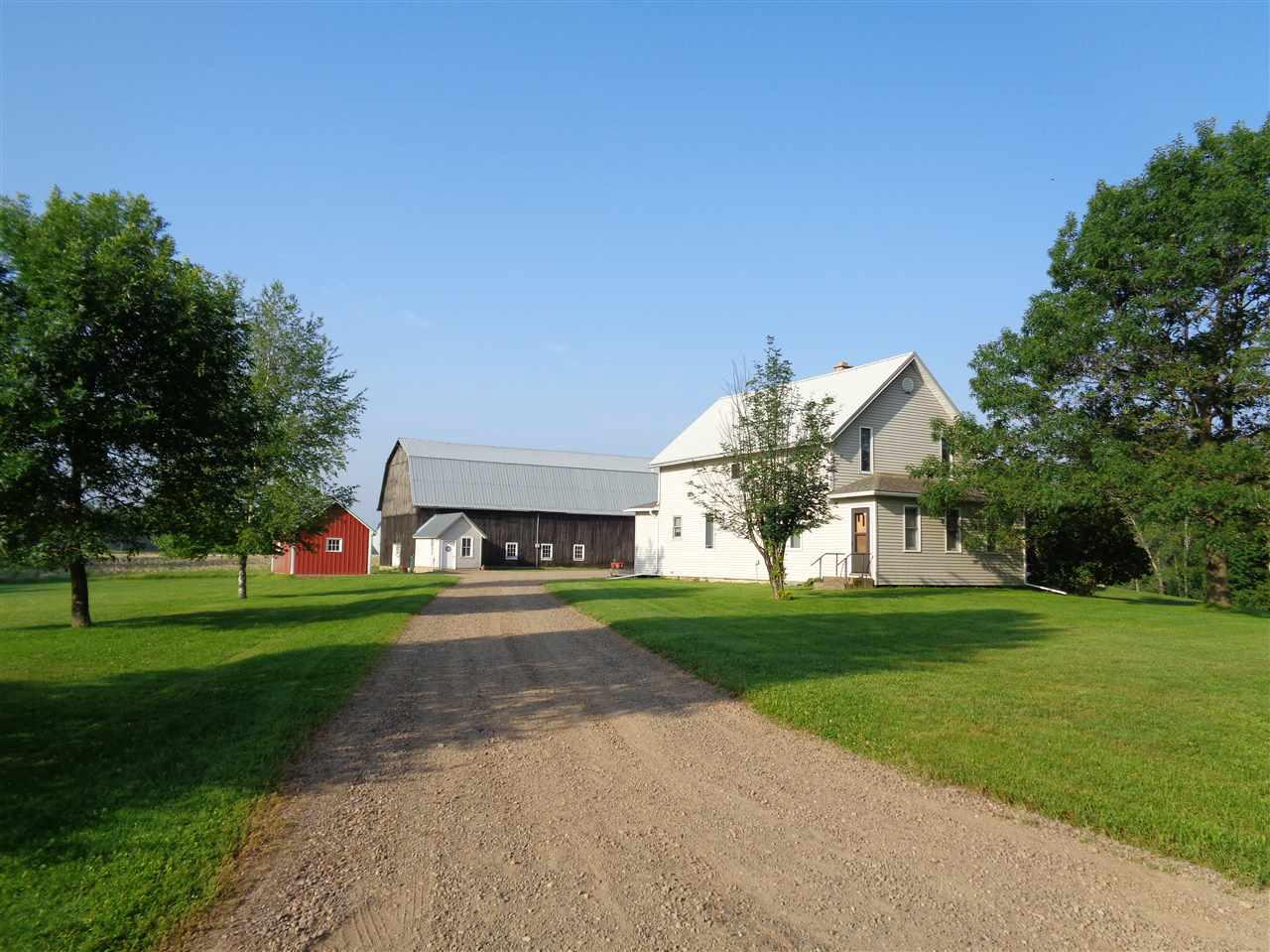 Remodeled country home or hobby farm on +/- 79.55 acres. 3 bedroom, 1.75 bathroom country home with spacious kitchen, main floor laundry and attached heated 3 car garage. Updates include remodeled first floor bathroom, added second floor bathroom and brand new master bedroom with walk-in closet. New dishwasher, stove, washer, dryer, flooring, trim/doors, plumbing, furnace, central air and custom Hunter Douglas blinds. Barn with stanchions, barn cleaner and 4 sheds. The +/- 79.55 acres is a mix of tillable and wooded land. This property was previously used as a fully operational beef farm. The stove, microwave, dishwasher, washer, dryer and window treatments are included in the sale price.