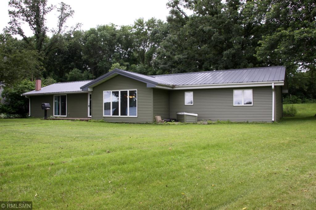 One level living- 3 bedrooms- open/sprawling home on Cedar Lake. New roof, new siding, blacktop drive. Pole shed garage 36x24 w/ heated and insulated (15x24) room off back. 1 sliding door too! Concrete front patio & sunroom. Great level lot!
